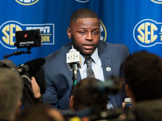 Auburn defensive lineman Dontavius Russell talks to