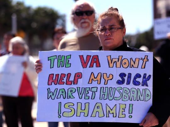 M. Donahue gathered with other protesters outside U.S. Rep. Blake Farenthold's office Saturday, February 25, 2017 to protest a variety of issues. She said it was the first time in her life she had picked up a sign, but the issues were that important to her.