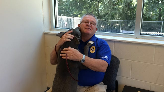 Montgomery County Animal Control Director Tim Clifton took part in the Kissed By A Pit Challenge and is asking others to do the same and donate food to the shelter.