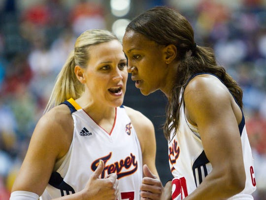 Katie Douglas left, and Indiana teammate Tamika Catchings talk during second half action, Atlanta Dream at Indiana Fever, Eastern Conference Finals, Conseco Fieldhouse, Indianapolis, Thursday, September 22, 2011.