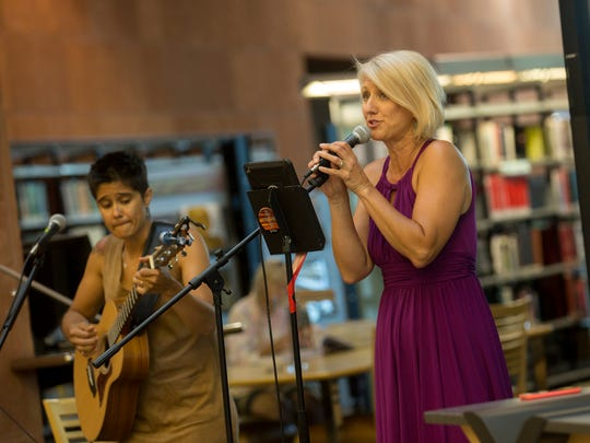 The Zia Chicks's Monica Leaming, left, and Cecilia Taulbee-Leaming perform Friday during the Cottonwood Concert Series at the Farmington Public Library.