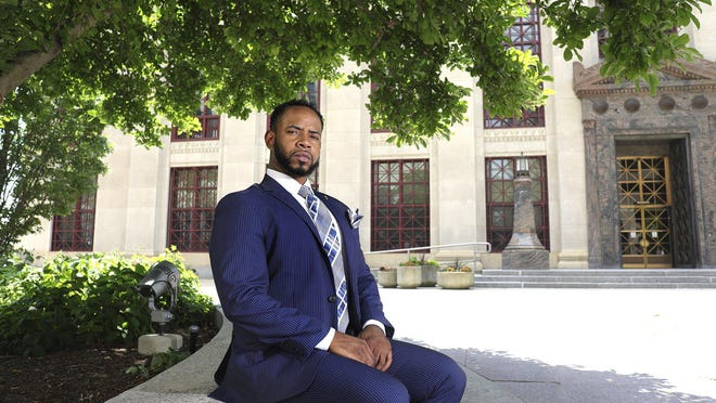 "Terry ""Nunnie"" Green, founder of Think Make Live Youth, a local nonprofit working with at-risk youth, poses for a portrait in front of Columbus City Hall on Thursday, July 9, 2020."
