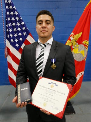 Marine Lance Cpl. Benjamin Gonzalez was presented the Navy Cross, the military's second-highest honor awarded for valor in combat, on Tuesday. Gonzalez was honored for his bravery in saving a fellow Marine during Operation Iraqi Freedom II in 2014.