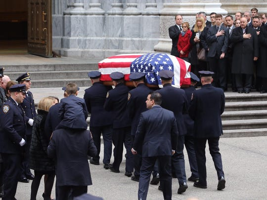 The casket of Joseph Lemm is carried into St. Patrick's Cathedral in Manhattan before the funeral of the West Harrison resident. Lemm, a member of the NYPD and Air National Guard, was killed fighting in Afghanistan on Dec. 21st.