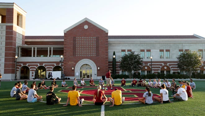 Student athletes gather for a workout Sept. 5 in front of the John McKay Center, an athletic facility on the University of Southern California campus in Los Angeles. USC draws more international students than any other U.S. university.