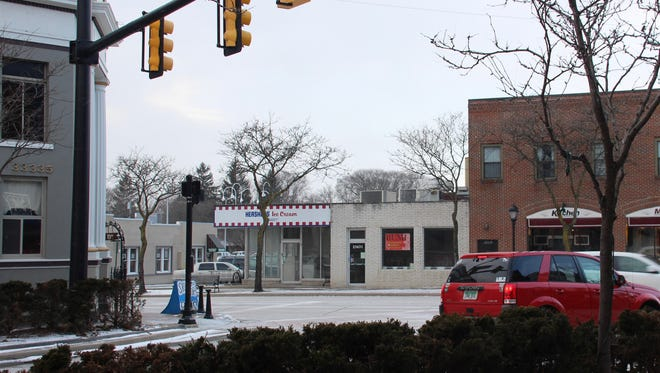 A view of the vacant Hershey's store from the patio at Cowley's.