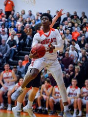 Northeastern's Quay Mulbah, seen here in a file photo, is one of the key returning players this season for the Bobcats. John A. Pavoncello