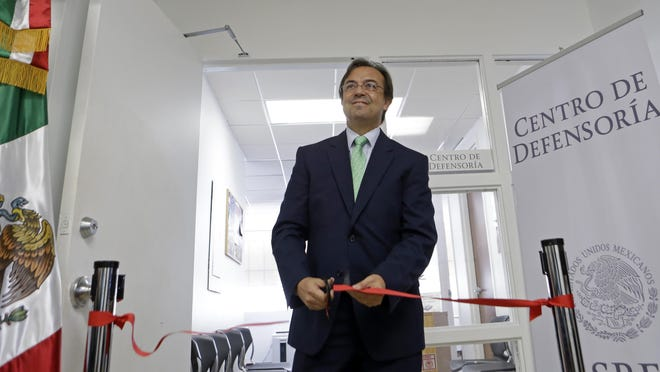 Mexican Consul General Jose Antonio Zabalgoitia officiates at the opening of a legal defense center Friday at the Mexican Consulate General in Miami. The Mexican government is beefing up its aid to migrants in the U.S. through the creation of 50 legal assistance centers.