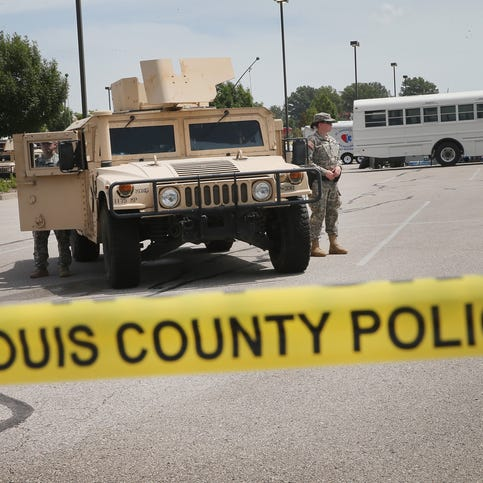 Military police with the Missouri Army National Guard stand guard at the police command center which was established to direct security operations following unrest after the recent death of Michael Brown on August 21, 2014 in Ferguson, Missouri.