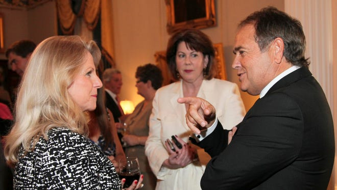Virginia first lady Maureen McDonnell, left, chat at a reception in the Executive Mansion in Richmond with Star Scientific CEO Jonnie Williams. Williams picked up the $15,000 catering bill for the 2011 wedding of one of McDonnell's daughters and financed a $15,000 shopping spree for Maureen McDonnell, the governor's wife, at Bergdorf Goodman.
