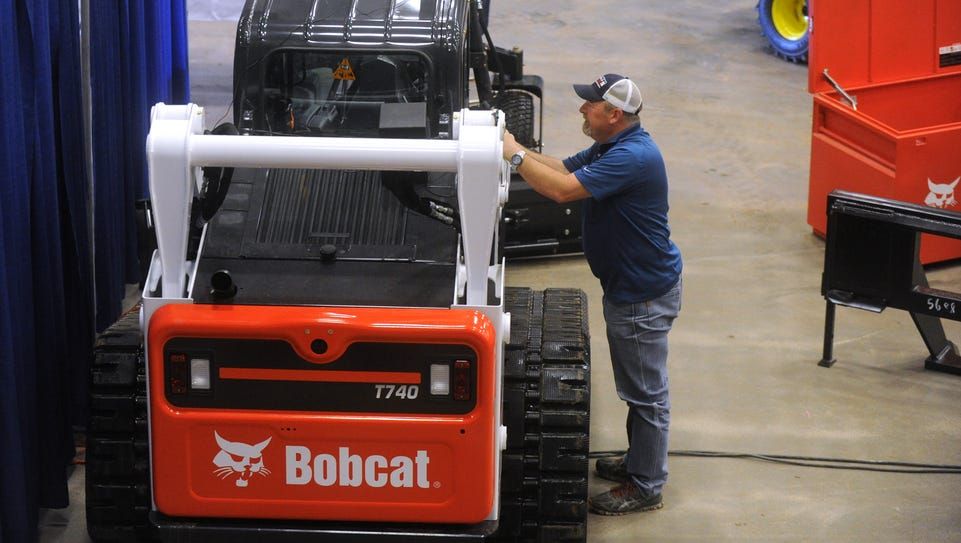 Chris Ellis with Bobcat of Abilene sets up his equipment