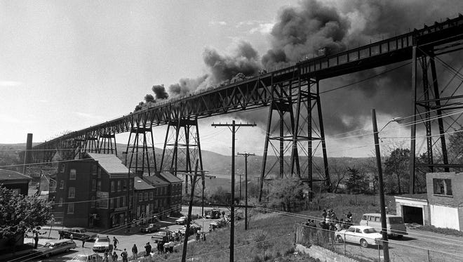 The Poughkeepsie Railroad Bridge, which opened in 1889, caught fire on May 8, 1974, in this photo looking west from Poughkeepsie. It is believed that sparks from train brakes may have been the cause of the fire, which ended rail transport on the bridge.