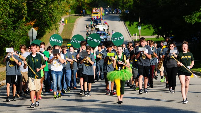 The Green Bay Preble High School marching band performs in the homecoming parade on Newberry Avenue, Friday, September 26, 2014.