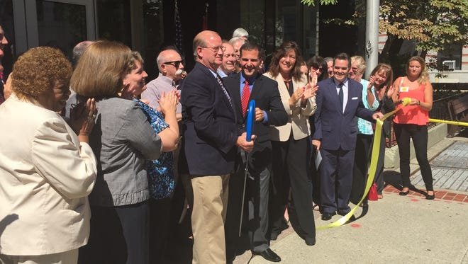 Dutchess County Clerk Bradford Kendall and County Executive Marc Molinaro cut a ribbon, celebrating the 300th anniversary for the County Clerk's Office.