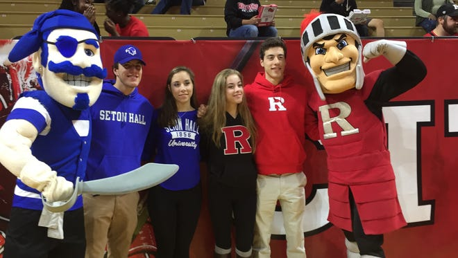 The Mailley quadruplets -- John, Meghan, Caitlyn and Connor -- pose with the Seton Hall and Rutgers mascots.