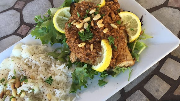 This spice sauce made with walnuts and garlic adds a rich flavor to any mild white fish. The dish was prepared by Marlene Elkhouri of Cedar's Cafe in Melbourne.