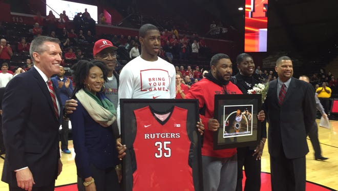 Rutgers center Greg Lewis gets his Senior Day jersey, flanked by his family, Rutgers AD Pat Hobbs and coach Eddie Jordan.