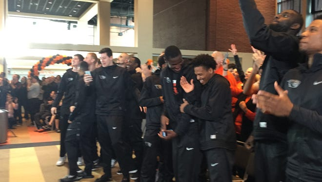Oregon State players react after learning they had been selected to play in the NCAA tournament.