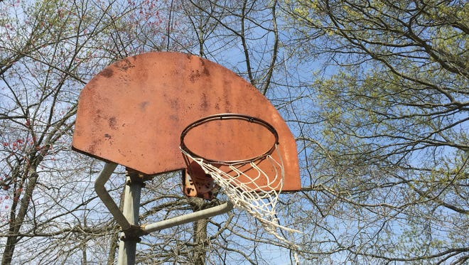 A rusted basketball hoop and backboard at Gravelly Brook Park in Matawan,