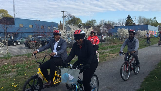 Roland Williams, left, rides an adult tricycle as the Roc Unity Riders train at the Conkey Corner Park in Rochester on Wednesday.