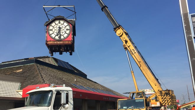 The Hour Time clock, a Lafayette landmark since 1979, was removed Tuesday morning from the top of the restaurant at Interstate 65 and South Street. The clock from the closed restaurant was sold for $7,500. The new owners haven't been identified.