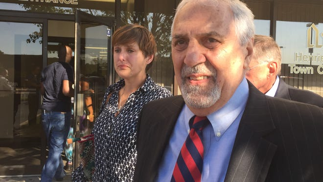 Attorney John Parrinello, right, said Thursday that an animal cruelty charge has been dismissed against Jocelyn Evans, left.