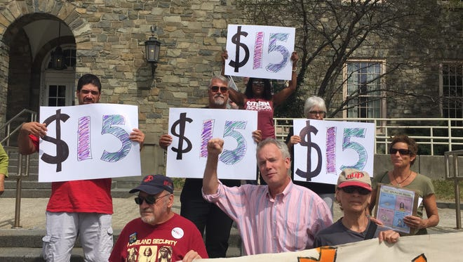 Dutchess County Legislator Joel Tyner, center, D-Clinton, leads a Labor Day rally for higher minimum wages and other workers' rights at the post office in the City of Poughkeepsie Monday, Sept. 5.