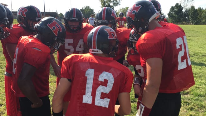 Rossview's football team huddles during practice earlier this season. Next year, the Hawks will move into Class 6A.