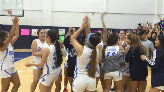 The St. Paul Warriors celebrate their win against the Okkodo Lady Bulldogs in girls basketball action on Nov. 19.