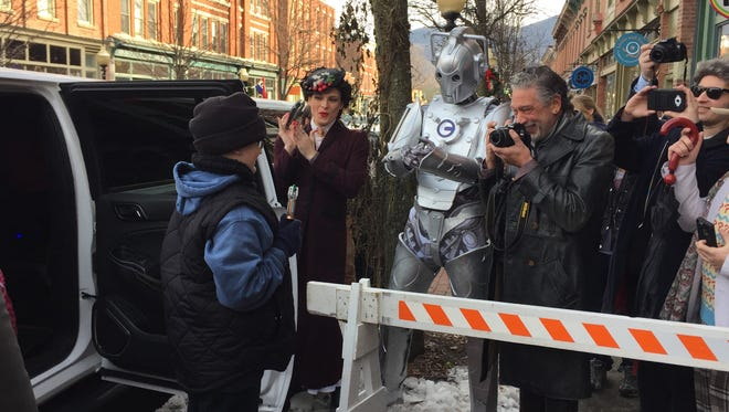 """Collin Cash, 11, greets people dressed as """"Doctor Who"""" characters outside of The Pandorica restaurant in Beacon. The avid fan, a Florida resident, visited the restaurant as part of his Make-A-Wish experience."""