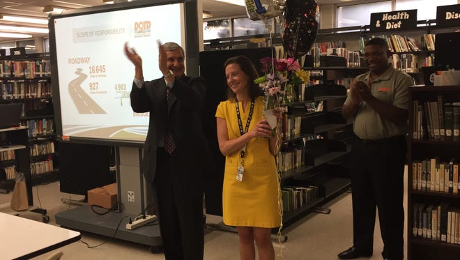 Christine McCrory, an Advanced Placement teacher at Lafayette High, celebrates being named the LPSS high school teacher of the year. Also pictured is Lafayette Parish Superintendent Donald Aguillard.