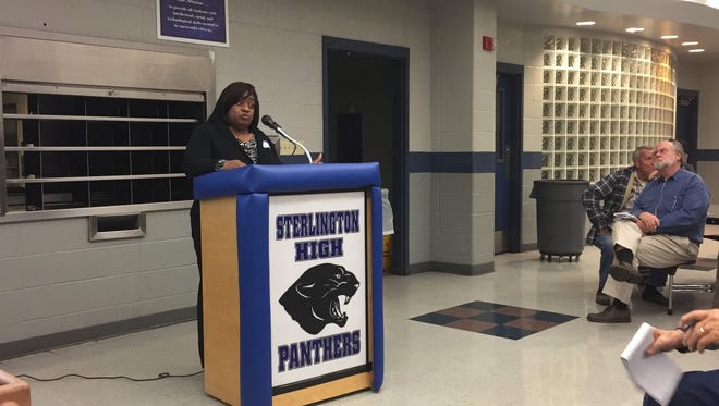 LaMetrice Dopson, director of customer care for Severn Trent — North America, explained the new plan for catch-up or true-up bills on Monday during a meeting at Sterlington High School.