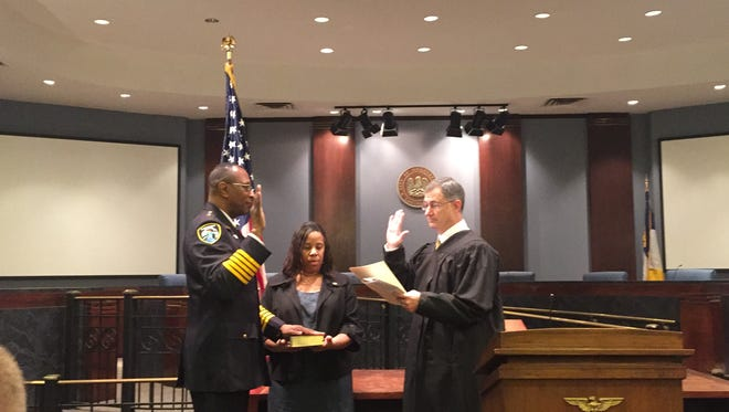 Police Chief Alan Crump takes the oath of office