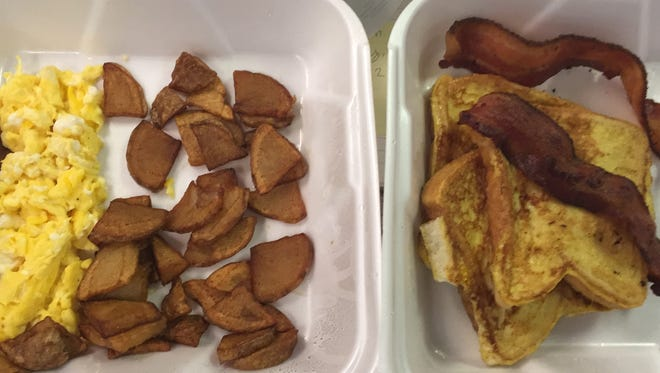 Centennial Cafe serves breakfast all day. Here, taken to go: French toast, bacon, home fries and scrambled eggs for $7.99 plus tax.