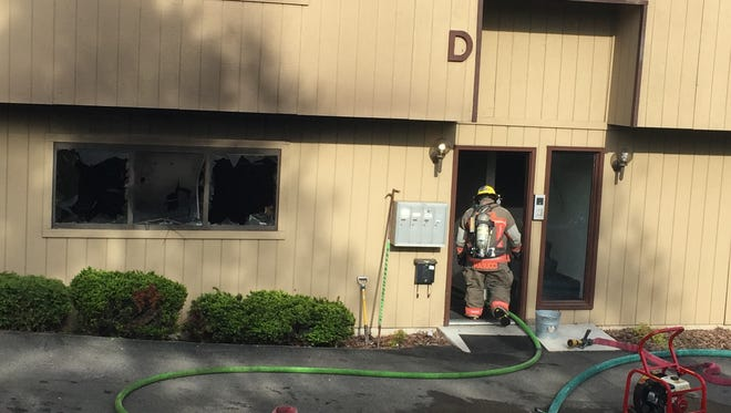 A firefighter enters an Endicott apartment Tuesday morning where a fire was blamed on a woman smoking while on oxygen.