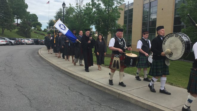 Candidates for degrees at the Mount Saint Mary College commencement are led to the ceremony by the MacLeods of Cornwall Pipes & Drums band on Saturday, May 20, 2017.