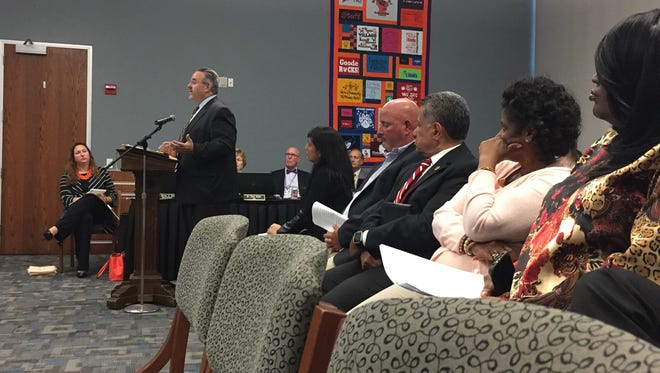 Helen Thackston Solicitor Brian Leinhauser, standing, addresses the board after York City superintendent Eric Holmes recommends to board members to pursue the revocation of the charter for Helen Thackston Charter School.