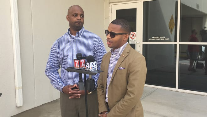 Derrick Quarles, who turned out to support Bruce Wilson, was arrested Tuesday following a bond hearing involving the Wilson family.