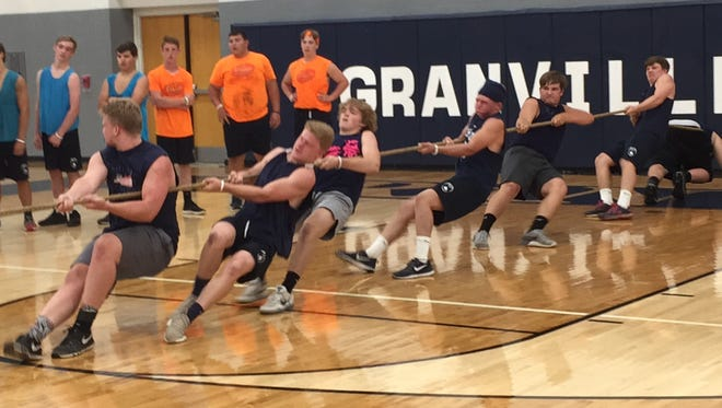 The Navy team goes all out to win the tug of war Sunday, during Granville team competition leading into Midnight Madness.