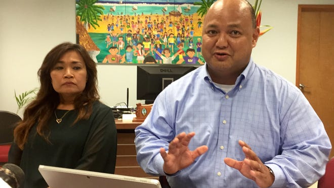 Superintendent Jon Fernandez says on Tuesday that public schools will open as scheduled on Thursday, August 17, pointing out that the emergency threat level has remained the same despite North Korea's renewed threats. Looking on is Erika Cruz, deputy superintendent of educational support and community learning.