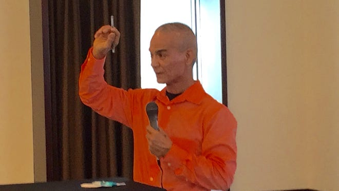 Guam Homeland Security Advisor George Charfauros gestures as he talks about North Korea's missile threats and Guam's safety and preparedness, during the Association of Government Accountants' Wednesday meeting at Sheraton Laguna Resort Guam.