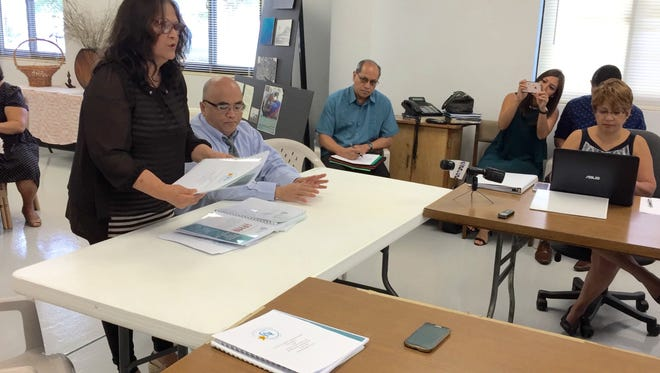 Marilyn Manibusan, left, Guahan Academy Charter School board liaison, along with board counsel Leonardo Rapadas, submit the school's annual reports for fiscal 2013 to 2016, results of the most recent student academic assessment, and a 2017 fact sheet, to the Guam Academy Charter Schools Council Thursday morning.
