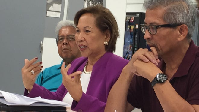 Guahan Academy Charter School Board Chairwoman Fe Valencia-Ovalles, center, asks the council overseeing charter schools to carefully review Guahan Academy's performance before even considering placing it on probation, during a council work session Thursday Nov. 9, 2017.