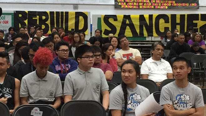 Simon Sanchez High School students wait for their turn Tuesday night to testify in support of a bill making the Guam Department of Education the lead procurement agency in rebuilding the Yigo campus.