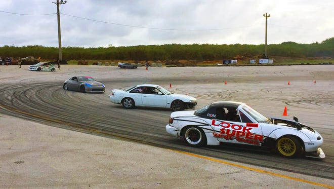 From left: Don Cabuhat, Jasper Leong and Ron Avelino go three wide April 15 at the Guam International Raceway in Yigo as part of the APL Guam Smokin' Wheels 2018 weekend.