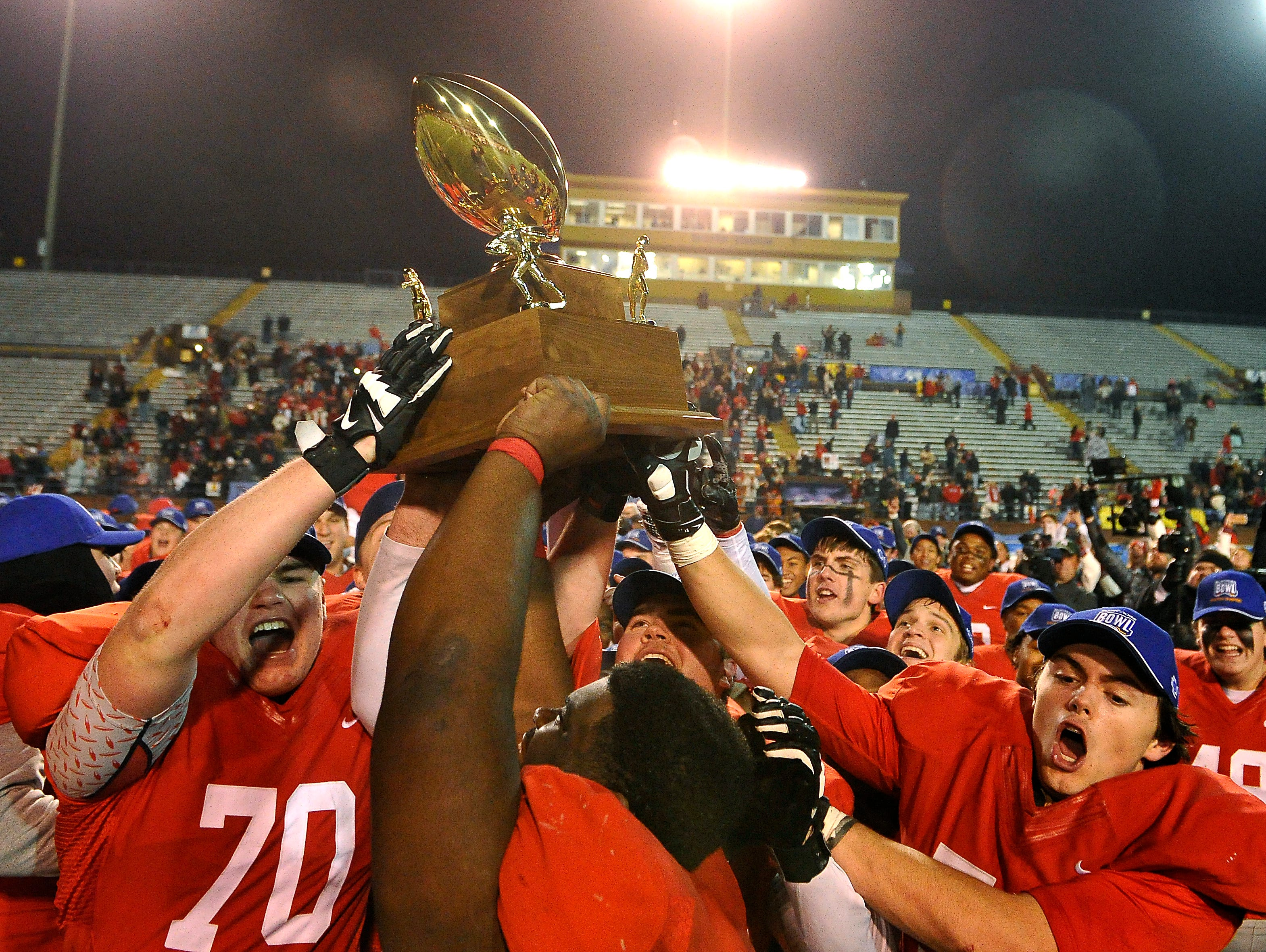 Brentwood Academy players celebrate their 56-55 double-overtime win over Montgomery Bell Academy in the BlueCross Bowl DII-AA state title game on Thursday, Dec. 3, 2015, in Cookeville.
