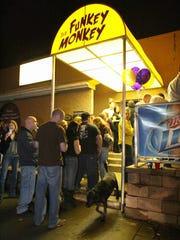 A line of customers wait to get into Funky Monkey on November 2009 in Wilmington.