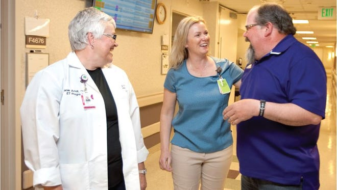 From left, Jane Arndt, clinical nurse specialist for Wound Ostomy Continence Care, and Bridget Froelich, PVH surgical unit nurse and educator, greet Kurt Kues, of Fleming, Colo., during his visit to the unit on Nurses' Week. Ten years ago, Kues was a patient at PVH and he returns each year to say thanks.