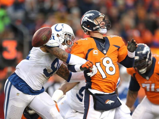 Indianapolis Colts linebacker Jonathan Newsome strips the ball from Denver Broncos quarterback Peyton Manning in the AFC divisional playoff game on Jan. 11.