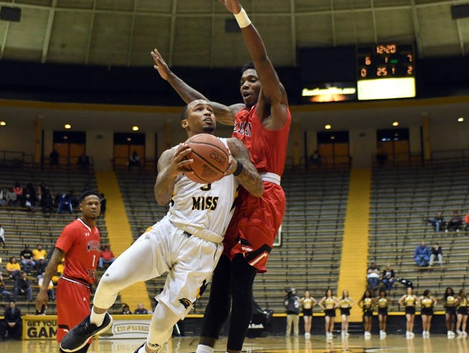 Southern Miss'  Tyree Griffin shoots for the basket